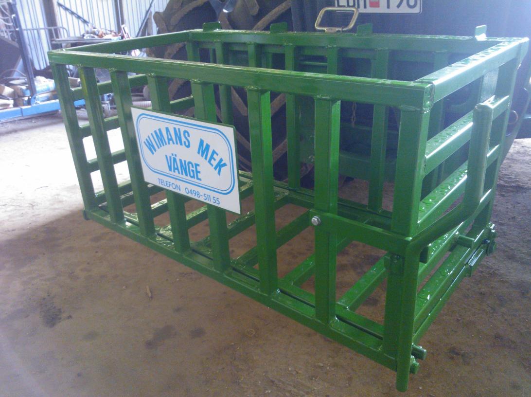 bild grön stenkorg till traktor